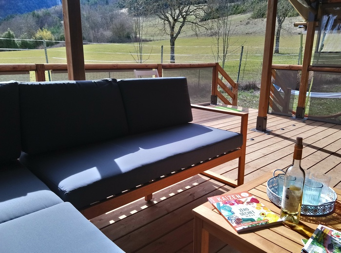 Le salon de la grande terrasse de la location Lodge Espace