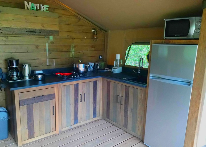La cuisine toute équipée de la location Lodge Espace